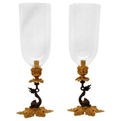 Pair of Reproduction Brass Candlesticks with Glass Hurricanes on Dolphin Bases