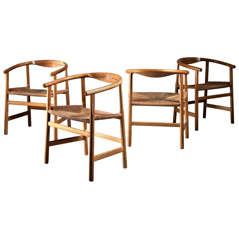 Hans Wegner Set of Four Beech and Papercord PP201 Armchairs, Denmark, 1960s