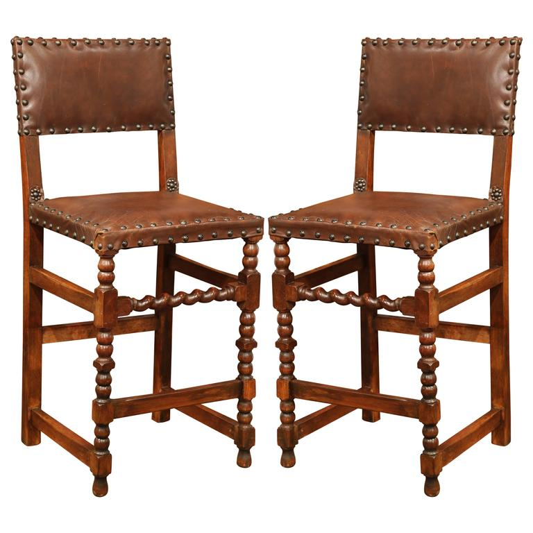 Pair of 19th Century French Carved Walnut Bar Stools with Original Brown Leather