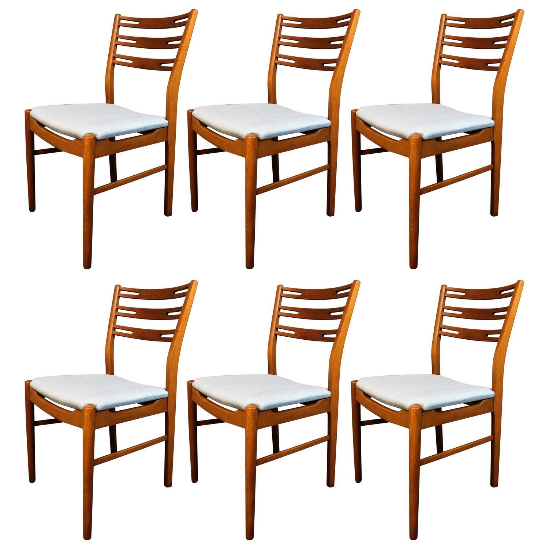 Six Danish Modern Teak and Walnut Farstrup Dining Chairs For