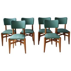 A set of 6 French 1950's Oak Chairs