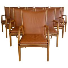 Set of Ten Danish Leather Covered Dining Chairs Attributed to Johs Andersen