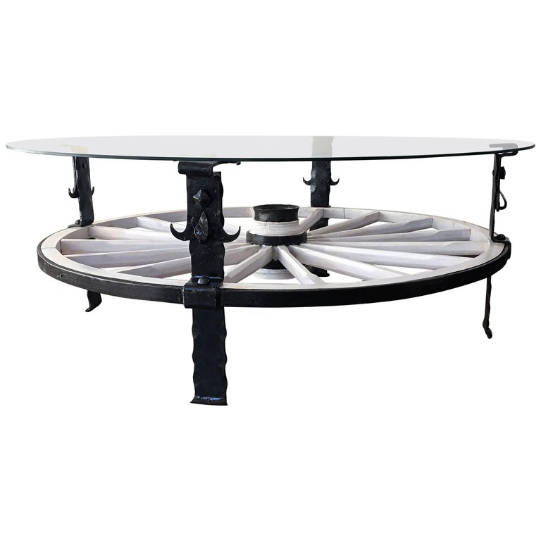 20th Century Glass Top Wooden Wagon White Wheel Accent Spanish Table For Sale