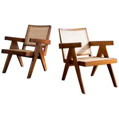 Pair of Pierre Jeanneret Teak and Cane Easy Armchairs