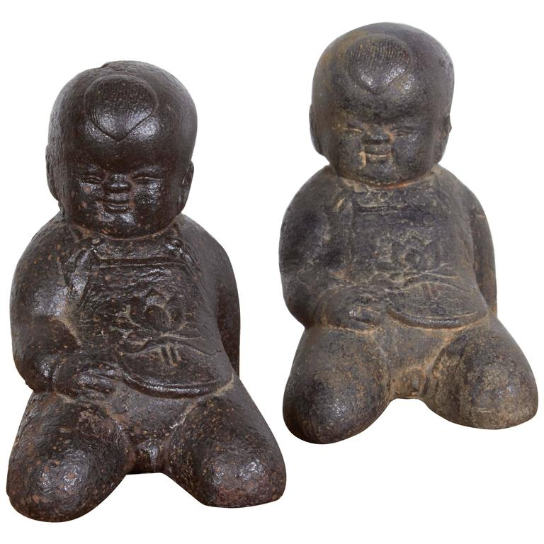 Pair of Adorable Cast Iron Babies
