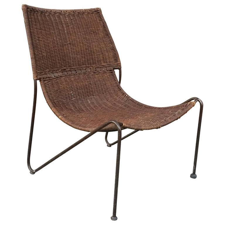 Woven Rattan And Wrought Iron Slipper Lounge Chair For Sale