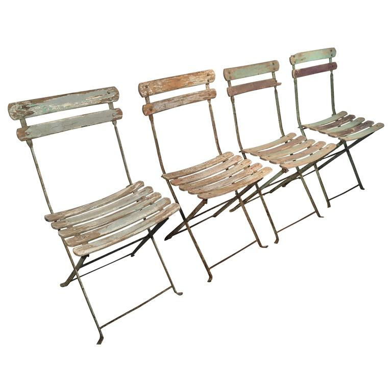 Set Of Four French Painted Wood And Iron Folding Bistro Chairs For