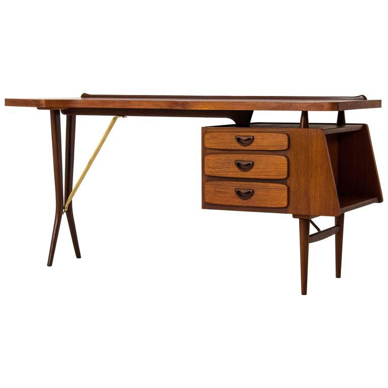 Iconic Mid Century Modern Desk by Louis Van Teeffelen for  : 5943923l from www.1stdibs.com size 768 x 768 jpeg 24kB