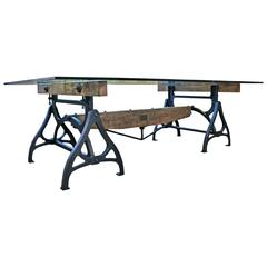 Vintage industrial dining display table at 1stdibs for Cast iron and glass dining table