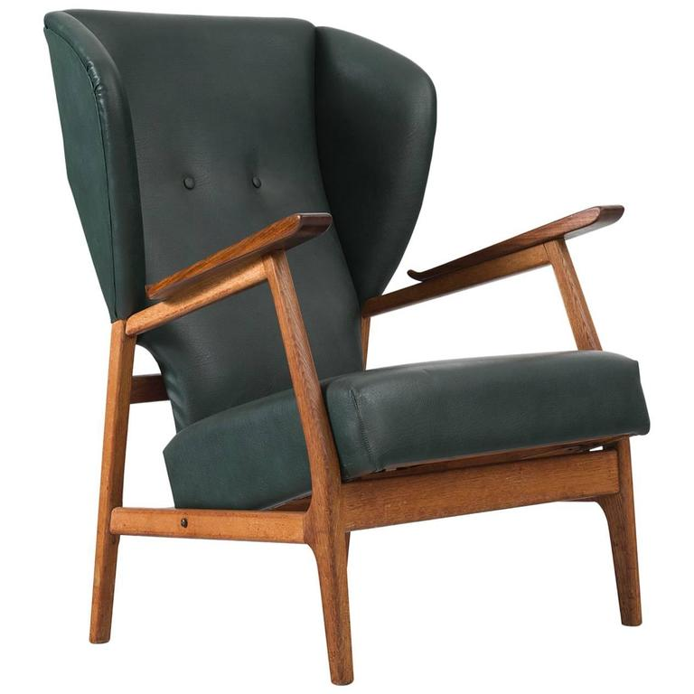 Superior Scandinavian Wingback Chair In Teak And Dark Green Upholstery 1