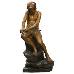 Late 19th Century Figure of a Young Seated Boy Carving by Goldscheider