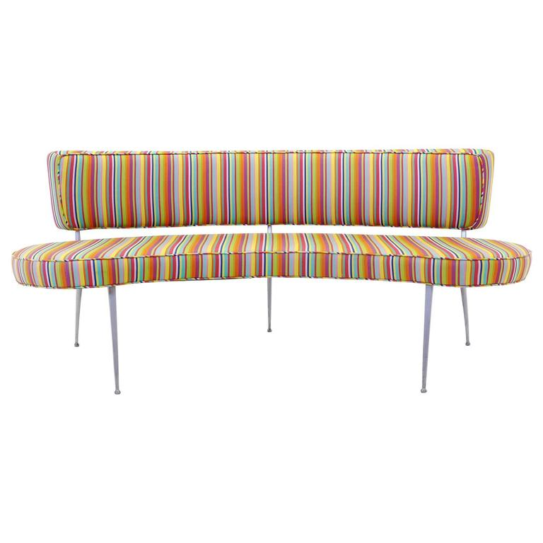 Custom built curved sofa bench with impala chair legs alexander girard fabric at 1stdibs Curved bench seating