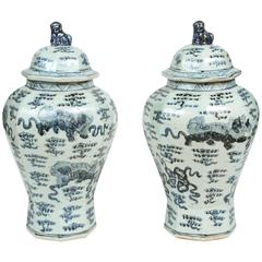 Pair of Vintage Chinese Ginger Jars with Foo Dogs and Clouds
