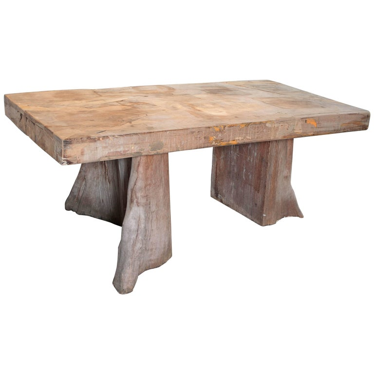 Slab top teak dining table with organic base supports at for Dining table support