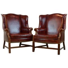Pair of Comfortable Vintage George III Style Leather Covered Wingback Chairs