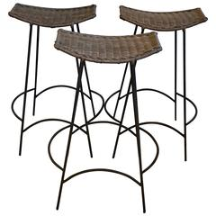 Three Arthur Umanoff Iron and Rattan Bar Stools