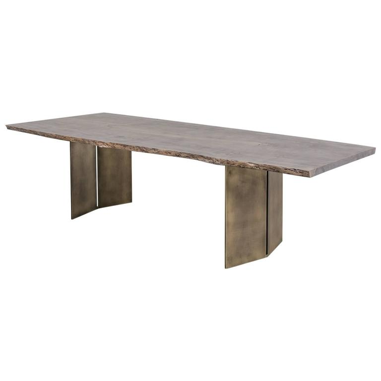Milo Base Dining Table by Uhuru with Grey Oak Slab Top and Antiqued Brass Base