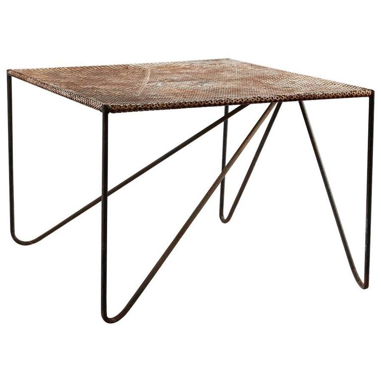 Rustic perforated metal side table with angled legs at 1stdibs for Rustic iron table legs