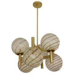 Italian Mid-Century Sculptural Brass and Murano White Striped Globe Chandelier