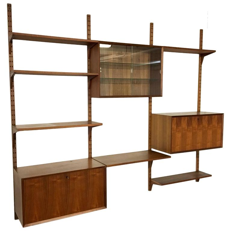 mid century modern cado system wall unit at 1stdibs. Black Bedroom Furniture Sets. Home Design Ideas