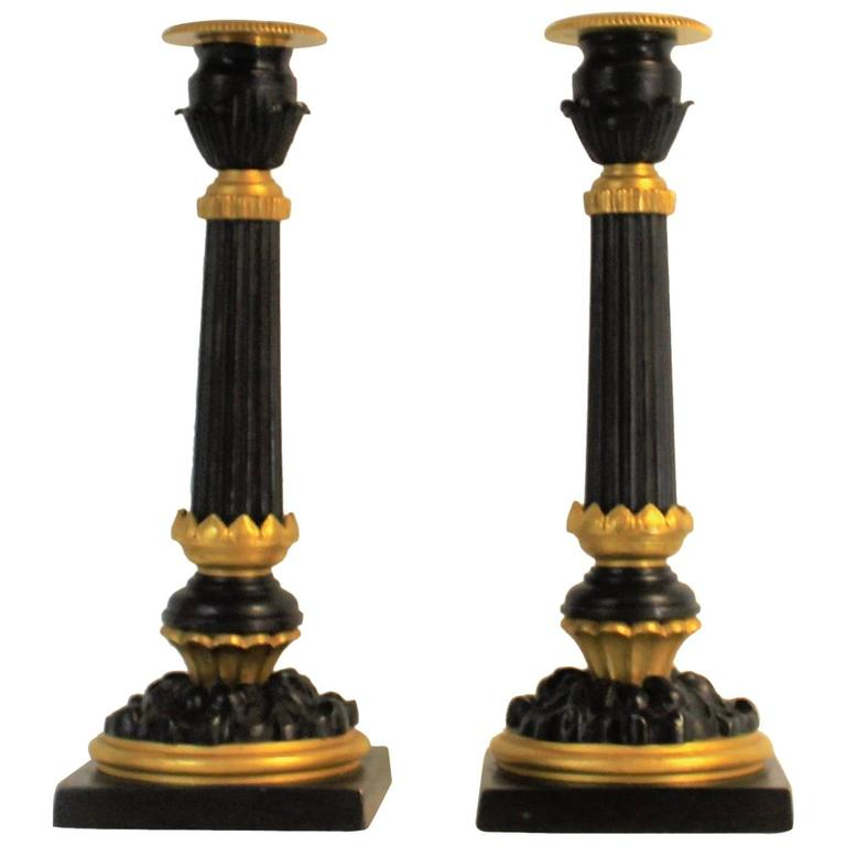 Pair of Neoclassical Bronze Candlesticks or Candleholders with Gilt Highlights
