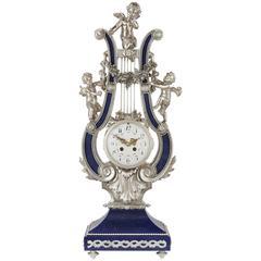 Louis XVI Style Silvered Bronze and Lapis Lazuli Lyre Shaped Mantel Clock
