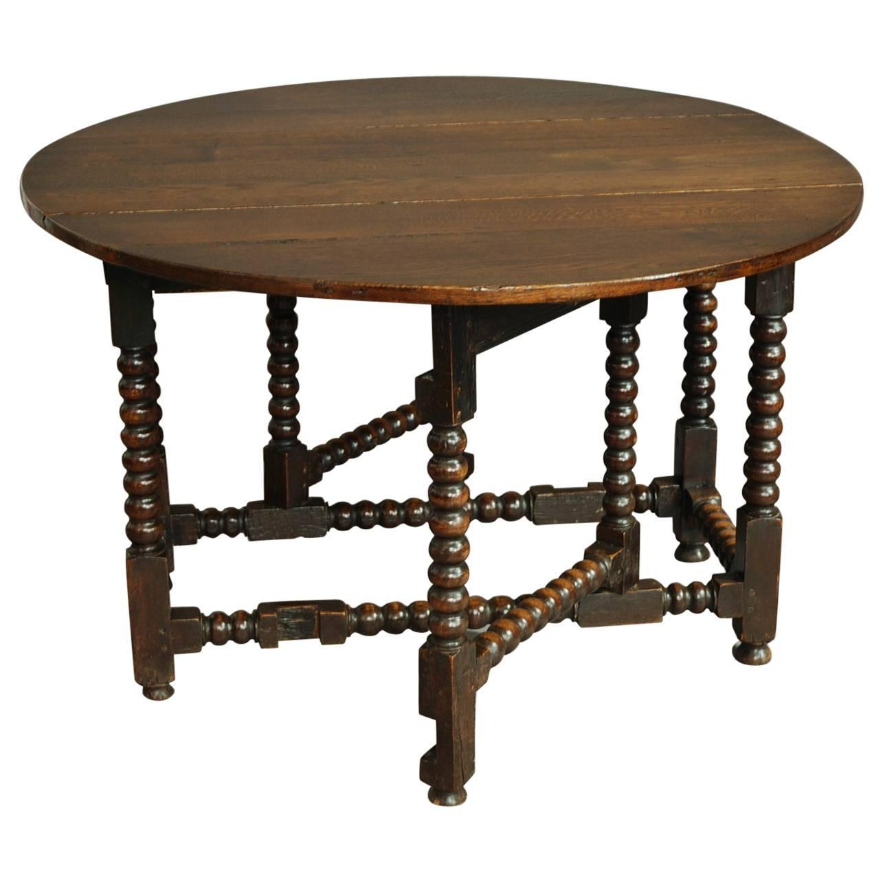 Large th century oak gateleg table with bobbin turned
