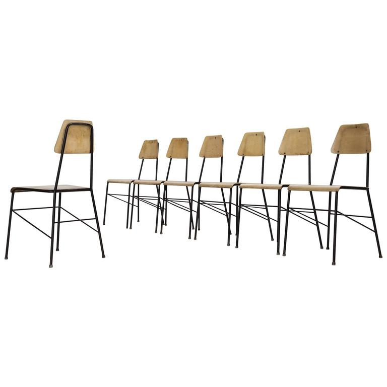 set of seven mid century dining room chairs in black metal