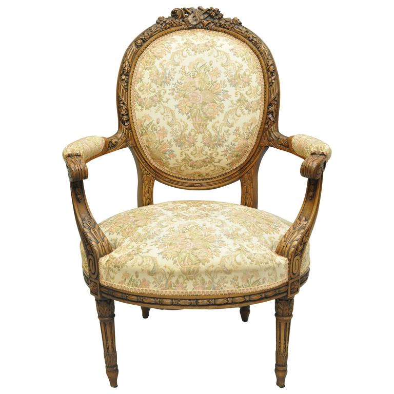 Early 20th Century Finely Carved Walnut French Louis XVI Style Fauteuil Armchair