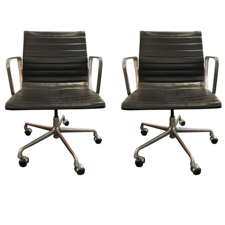 pair of leather charles and ray eames aluminum group