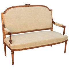 French Upholstered Settee of Carved Walnut
