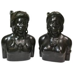 Pair of Carved Wooden Bust Sculptures of Tribal Male and Female
