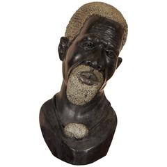 Carved Black Stone Bust of a Tribal Bearded Elder