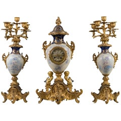 19th Century French Gilt Bronze and White Porcelain Three-Piece Garniture Set