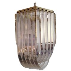 Hollywood Regency Brass and Lucite Ribbon Loop Chandelier