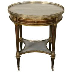 Louis XVI Style Round Table in Mahogany and Gilt Bronze by Gervais Durand