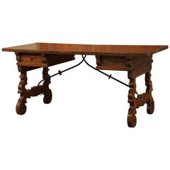 Early 20th Century Spanish Carved Walnut Desk with Wrought Iron Stretcher