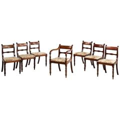 Set of seven Regency period (six plus one) mahogany chairs