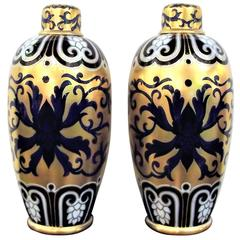 Pair of Hand-Painted and Gilt Porcelain Urns