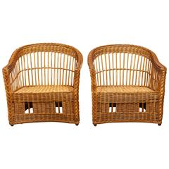 Pair of McGuire Rattan and Wicker Club Lounge Chairs and Ottoman