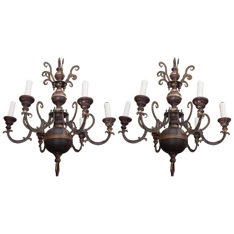 Pair of Italian Wood and Iron Chandeliers