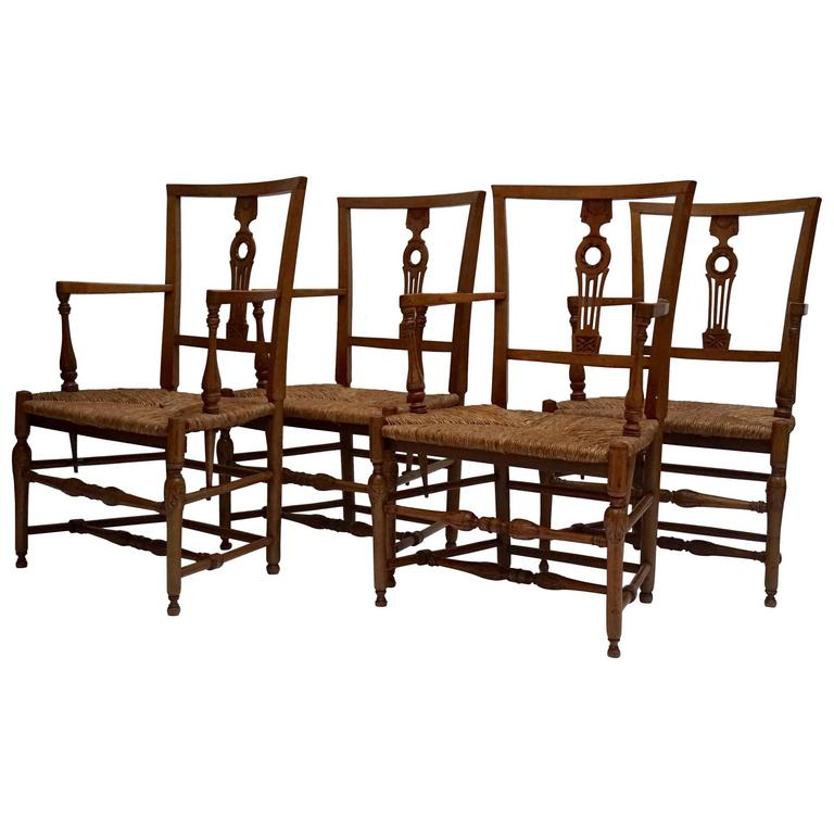 Set of Four Wicker Arm Chairs