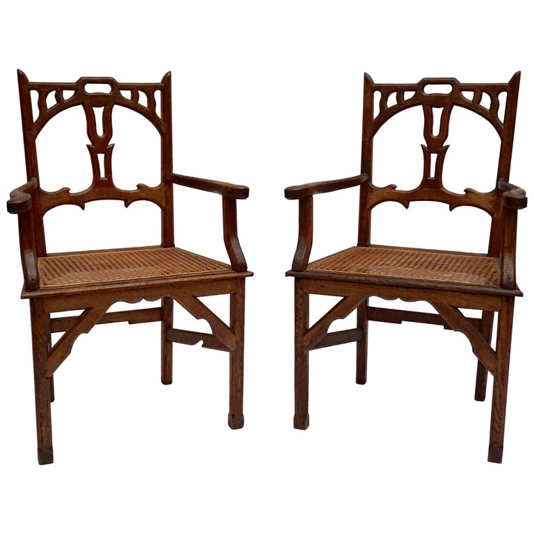 Two Italian Art Nouveau Carved Teak Armchairs For Sale