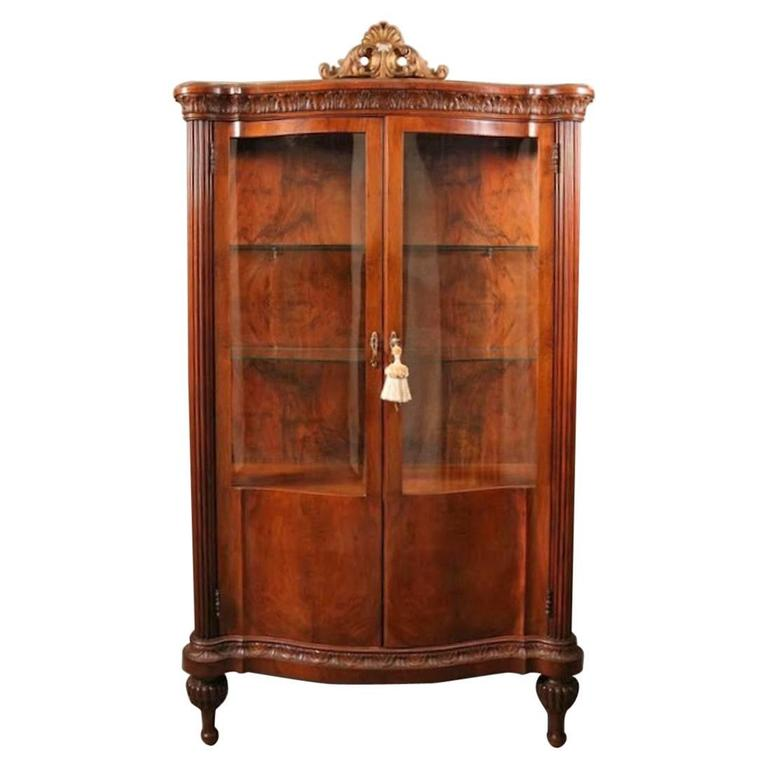 antique french style mahogany serpentine china cabinet