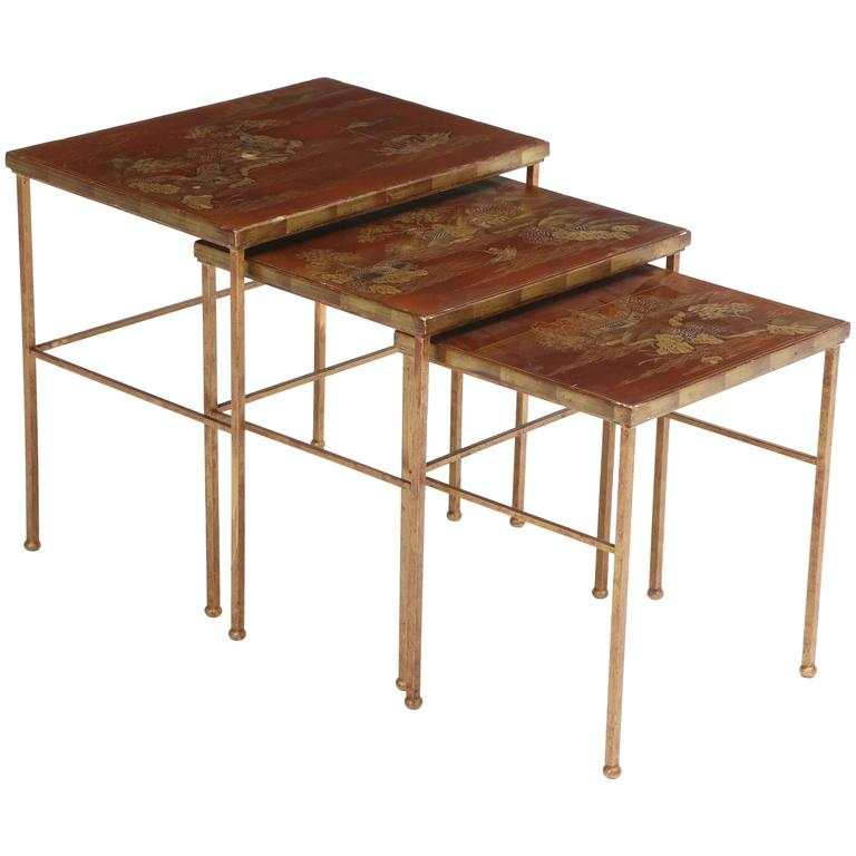 Set of gilt iron and lacquered nesting tables at stdibs