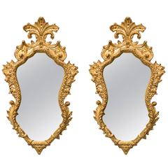 Pair of 1940s Italian Carved Gilt Wood Mirrors with Antiqued Glass