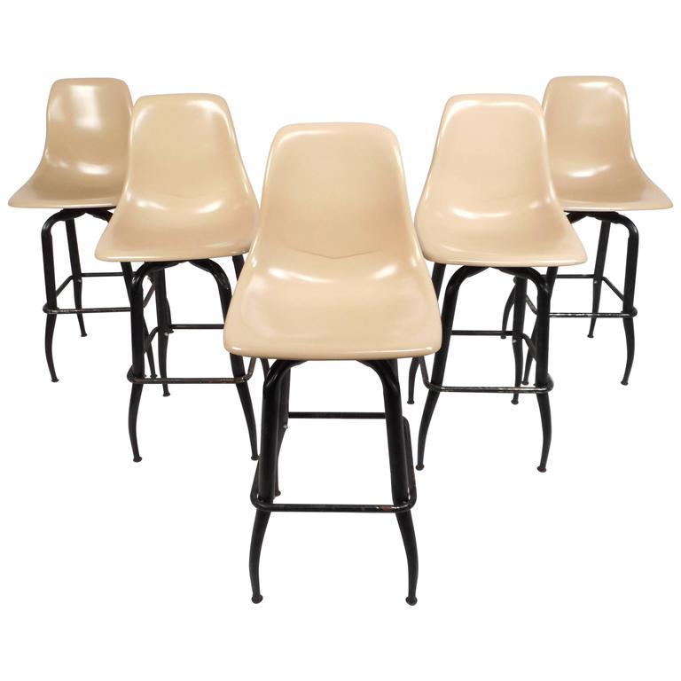 Set of Mid-Century Modern Plastic and Iron Swivel Bar Stools