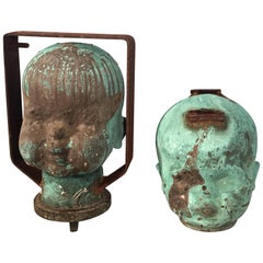 Two Verdigris Bronze Doll Head Molds