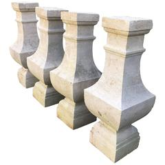 Two Pairs of Carved Limestone Balusters with Provenance