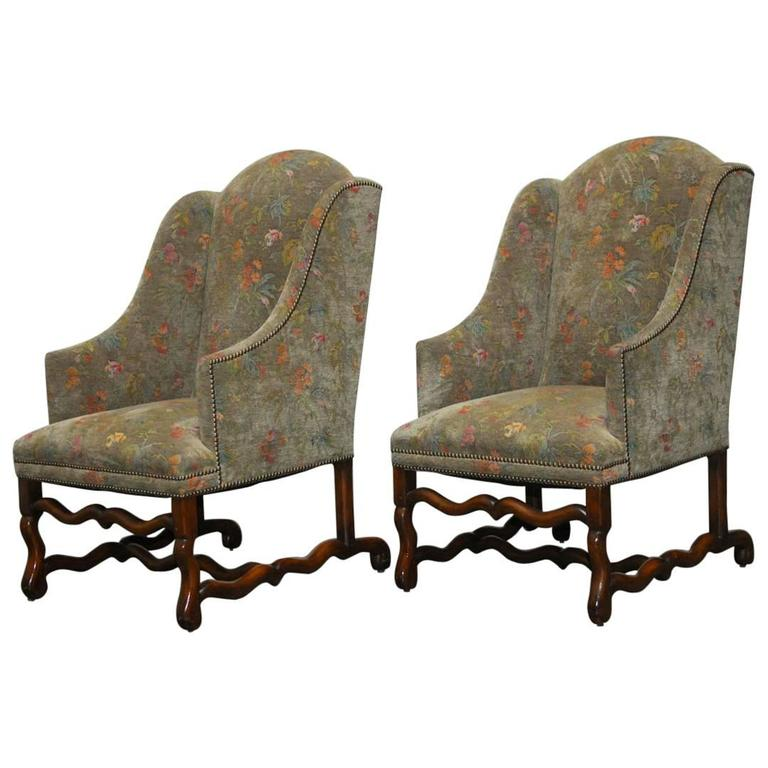 pair of walnut os de mouton upholstered wingback chairs 1